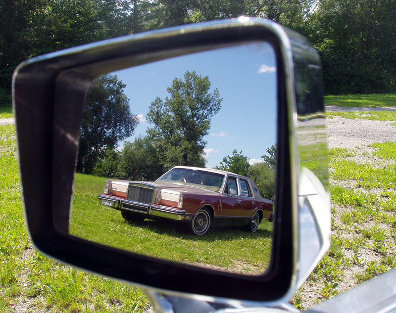 Continental Mark VI in Mark V's outside mirror